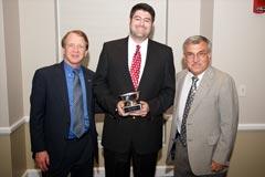 WRUF-AM/FM:  Dean John Wright, Matt Cretul (Red Barber Award), and Division of Multimedia Properties' Sports Director Steve Russell.