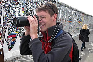 UF photojournalism student David Gardner takes pictures at one of the remaining segments of the Berlin Wall.