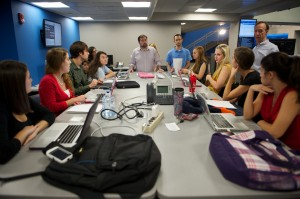 Matt Sheehan (center) works with a team of journalism students in the Innovation News Center during the 2012 presidential election.