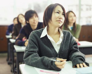 University Students Sitting in a Classroom, Young Woman Looking Up