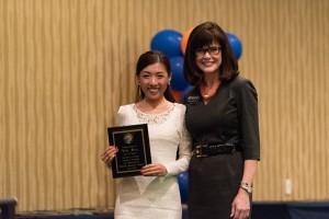 Faculty Research Award winner Rita Men with Dean Diane McFarlin.