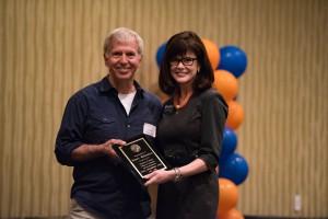 Faculty Advising/Mentor Award winner James Babanikos with Dean Diane McFarlin.