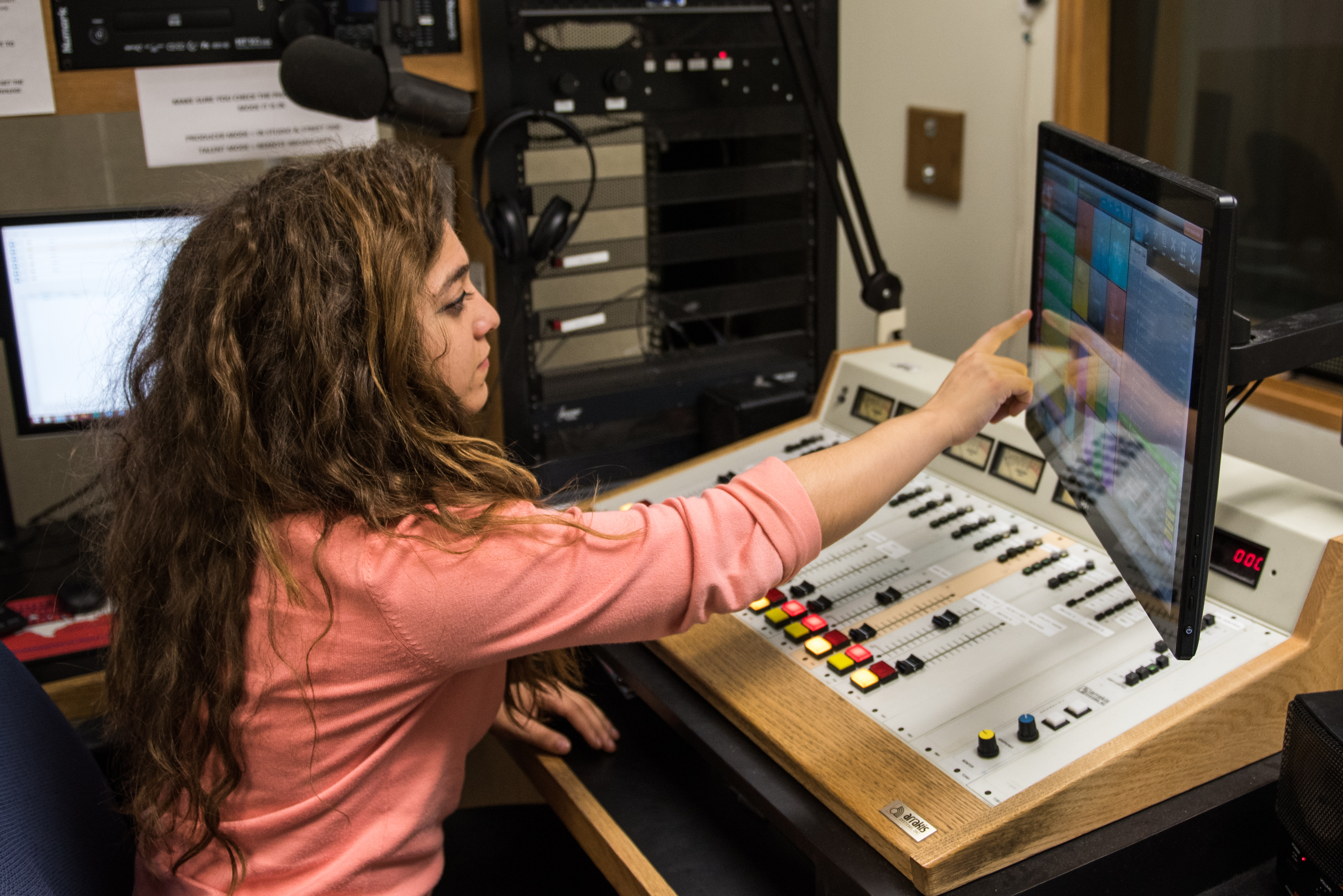 Student in radio master control.